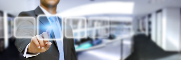 Businessman in his office using tactile interface / © sdecoret / Fotolia.com.